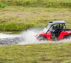 Race through puddles and rivers on a buggy tour.