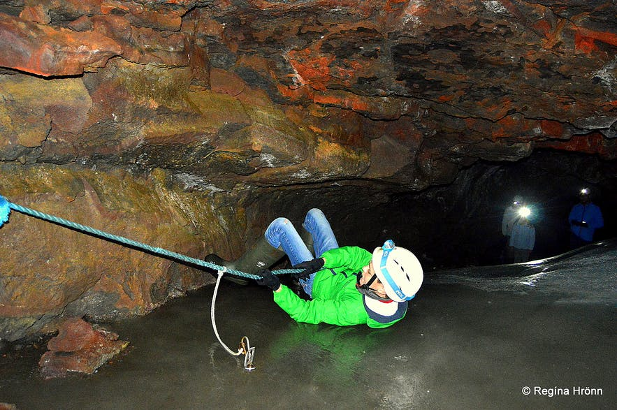 Sliding on a rope in Lofthellir cave