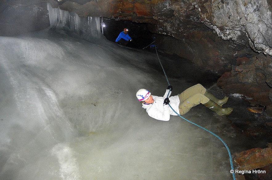 Sliding down the ice in Lofthellir cave