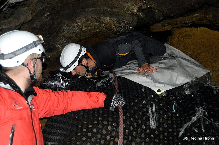 Squeezing through the entrance to Lofhellir cave