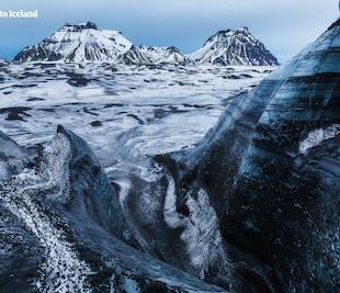 3 ใน 1 ทัวร์ทำกิจกรรมลดราคาพิเศษ |ขับรถเลื่อนหิมะ, ปีนธารน้ำแข็ง & ถ้ำน้ำแข็ง