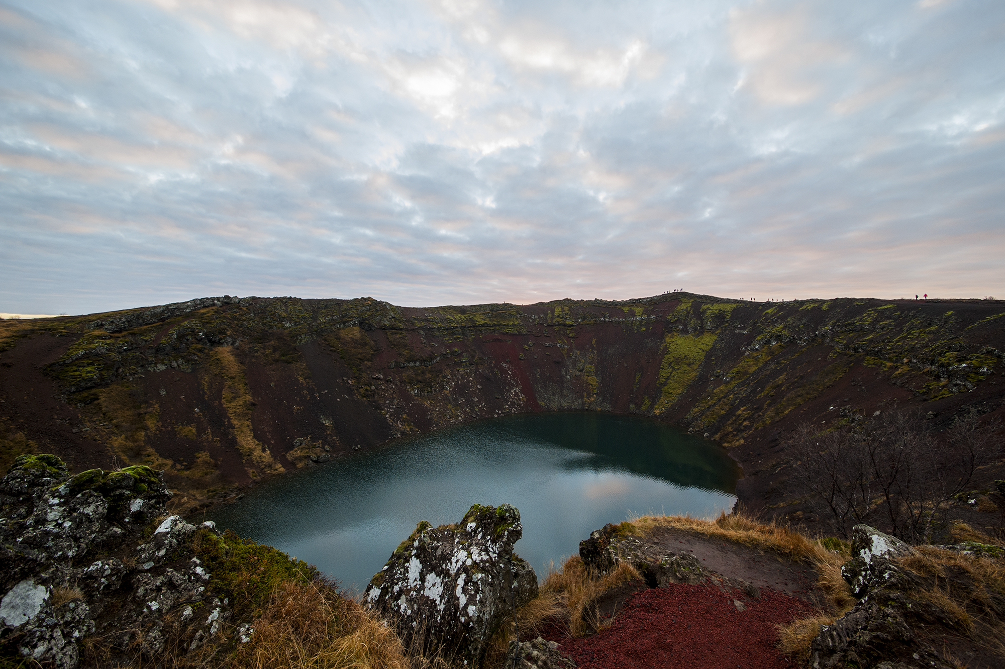 See the red walls and turquoise water of the crater lake Kerið on this Golden Circle minibus tour.