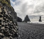 The hexagonal cliffs and black pebbles of Reynisfjara beach.