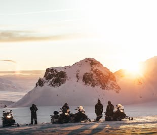 Midnight Sun & Snowmobiling Tour | Departure from Husafell
