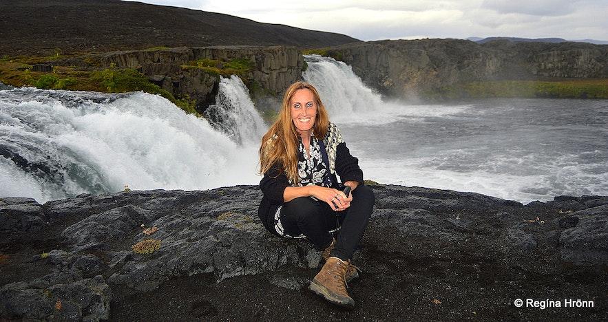 Regína by Skínandi waterfall in Svartá river