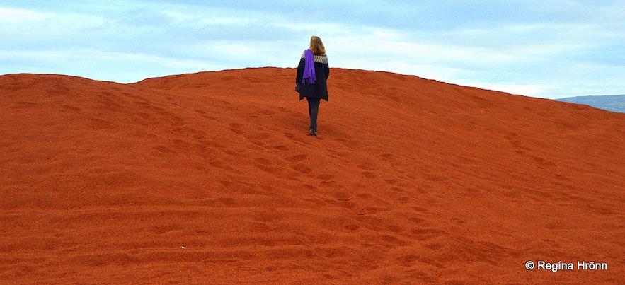 Regína on the red sand of Seyðishólar craters South-Iceland