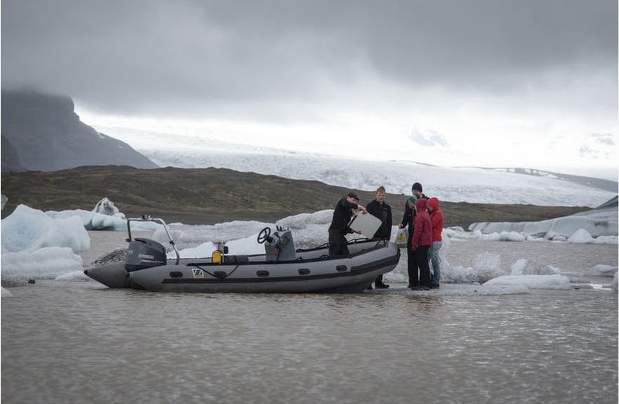 Picnickers being rescued from the glacial lagoon.