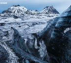 See the dark, volcanic streaks in the white ice of Sólheimajökull glacier on a glacier hiking tour.