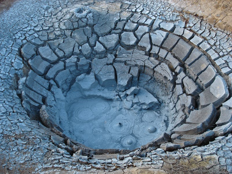 Muddy, scolding hot spring in Iceland