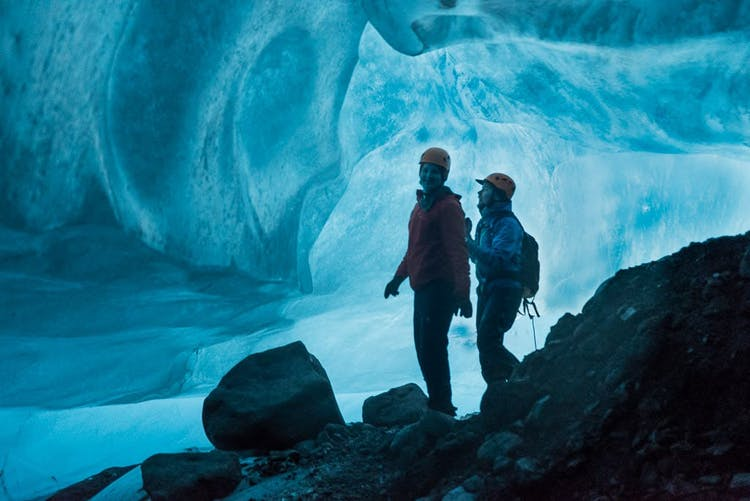 Natural glacier ice caves in Iceland have incredible blue colour inside.