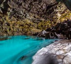 A beautiful pond inside an ancient lava tube in North Iceland.