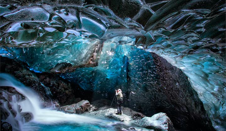 Find the perfect photo opportunity in an ice cave.