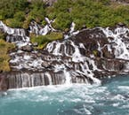 Hraunfossar is best described as a series of waterfalls.