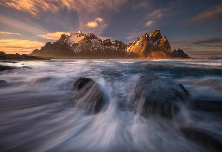 The dramatic Vestrahorn mountain captured through the waves.