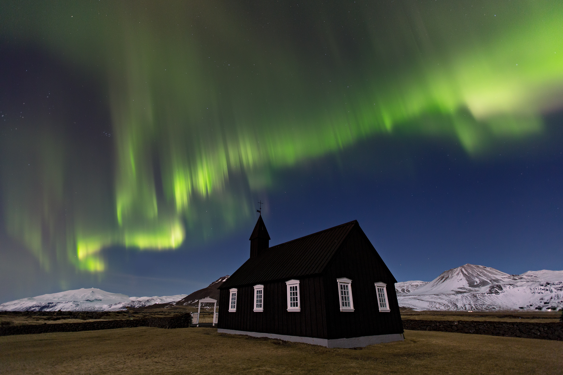 Northern Lights dance across the sky above this charming black church on the Snæfellsnes Peninsula.