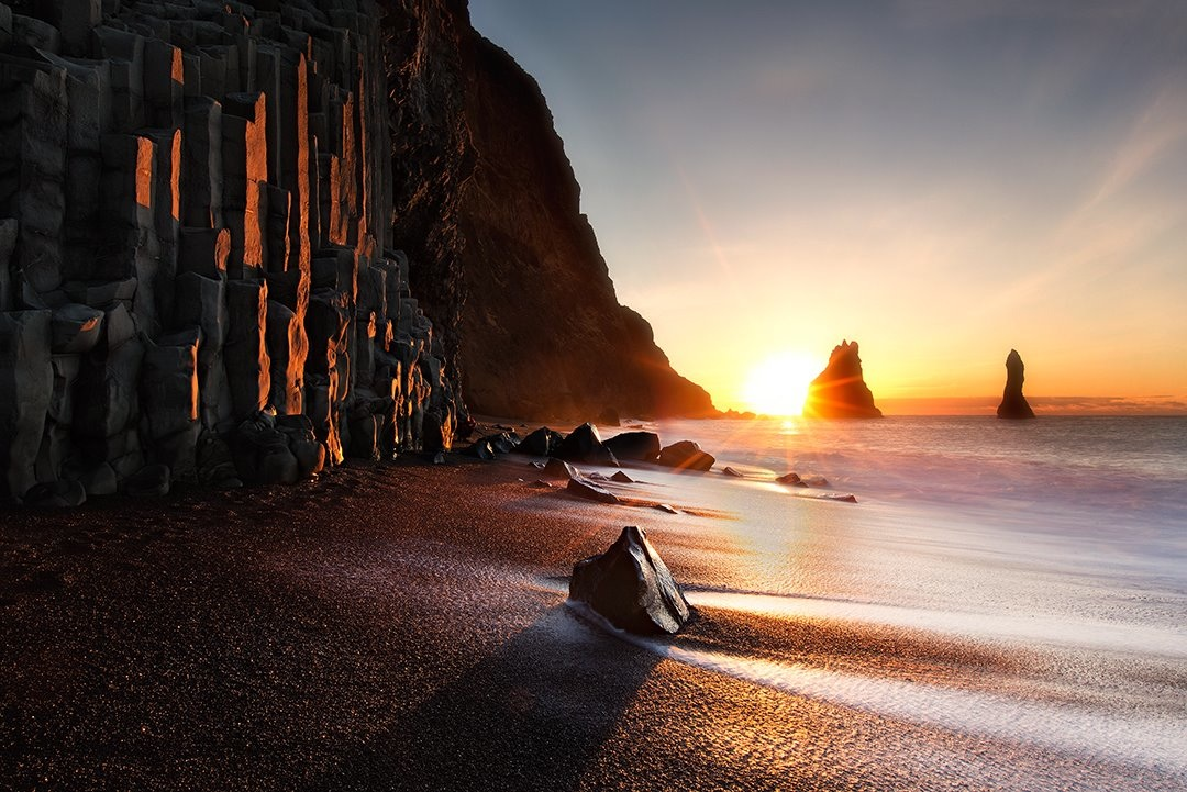 The sea stacks at sunset at Reynisfjara black sand beach.
