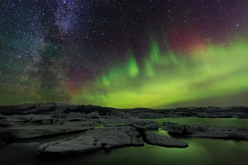 Northern Lights dancing across the sky at Jökulsárlón glacier lagoon.
