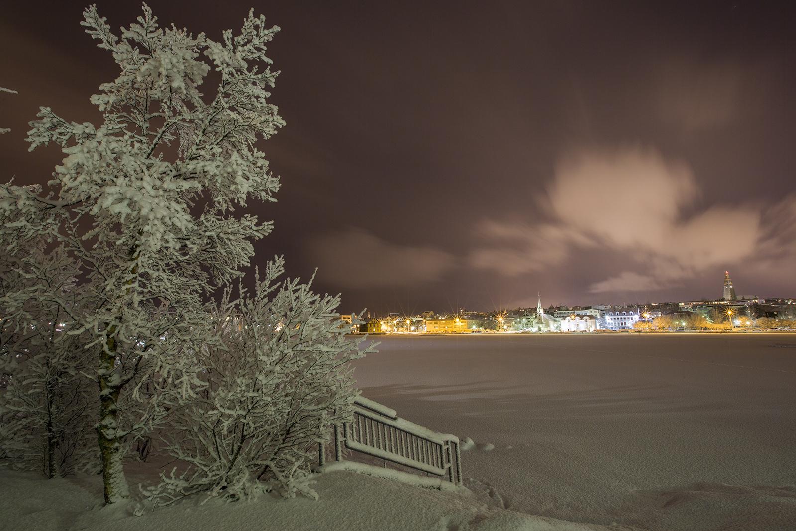 The Tjörninn pond in Reykjavík blanketed in powdery snow.
