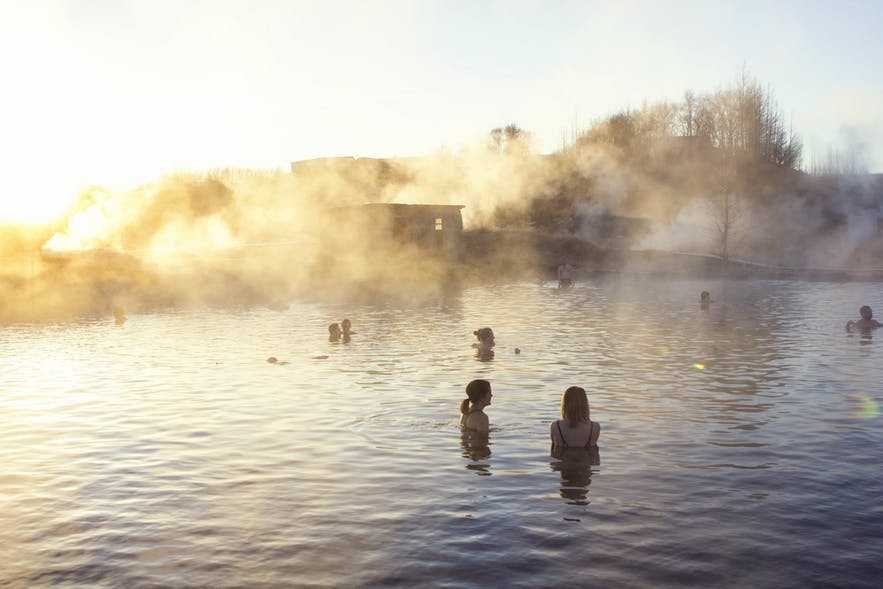 Bathers relax in the Secret Lagoon, Iceland's oldest outdoor pool.