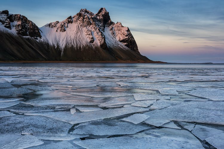 The dramatic Vestrahorn mountain in a sea of ice.