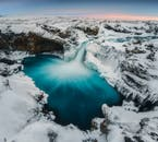 Admire the fascinating ice shapes of Aldeyjarfoss waterfall.