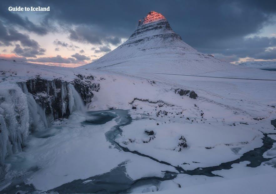 Kirkjufell and Kirkjufellsfoss by winter.