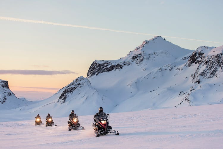 Race across Langjökull glacier on a snowmobile and feel the adrenaline surging in your veins.