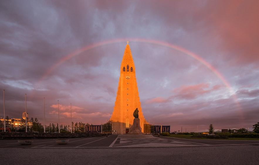 Iceland's largest church beneath a rainbow.