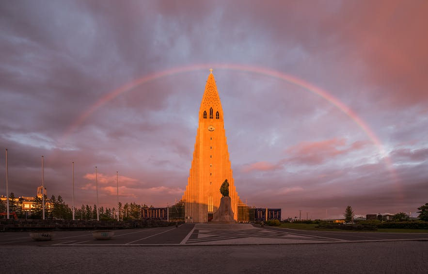 Iceland's largest church beneath a rainbow.
