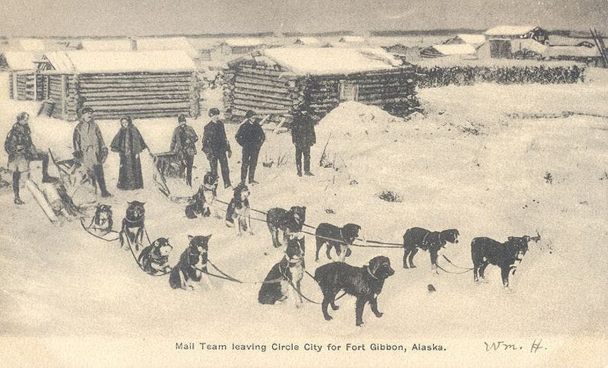 A postcard with showing a mail team in Alaska, circa; 1900.