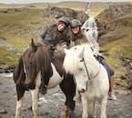 Two happy travellers on Icelandic horses