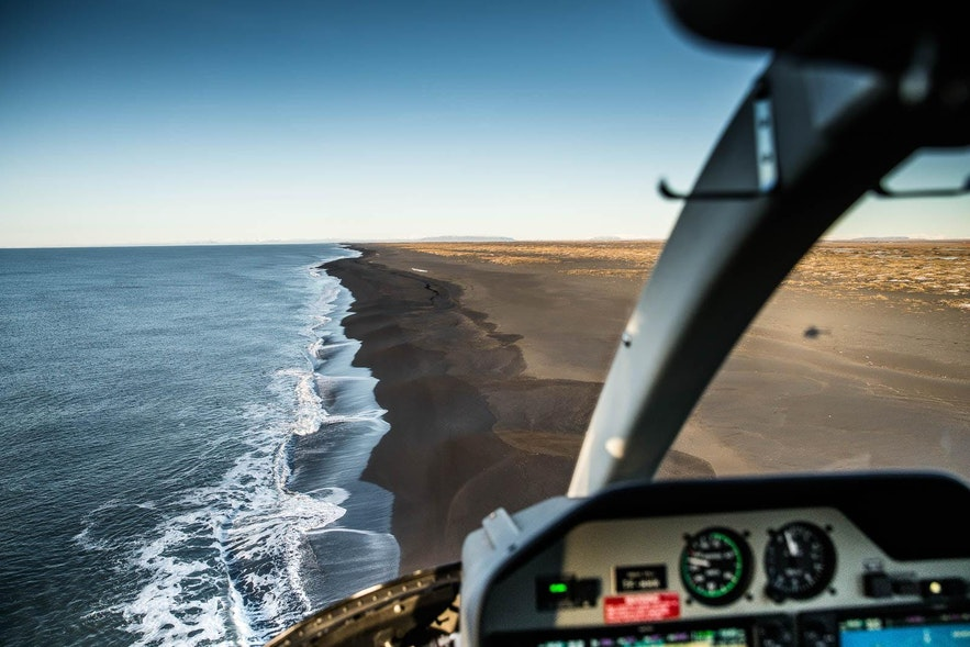 A helicopter flying over Iceland's gorgeous South Coast.