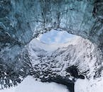 Looking up at the sky from inside an ice cave.
