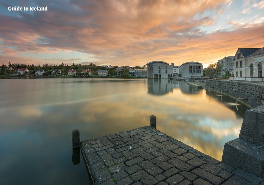 Reykjavík's famed Tjörnin lights up in summer, presenting an idyllic view of swans on the water