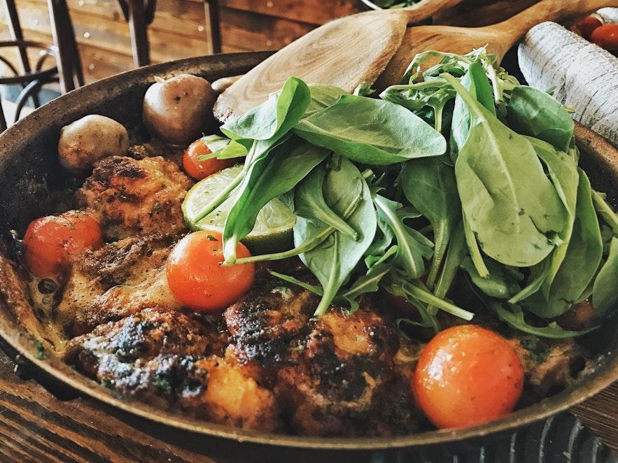 Pan of fish, potatoes and salad at Messinn restaurant