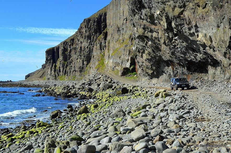 Driving by Skútabjörg cliffs in the Westfjords