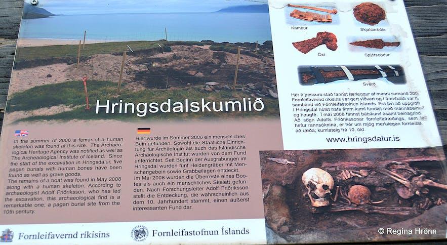 An information board detailing the Hringdalskumlið pagan graves
