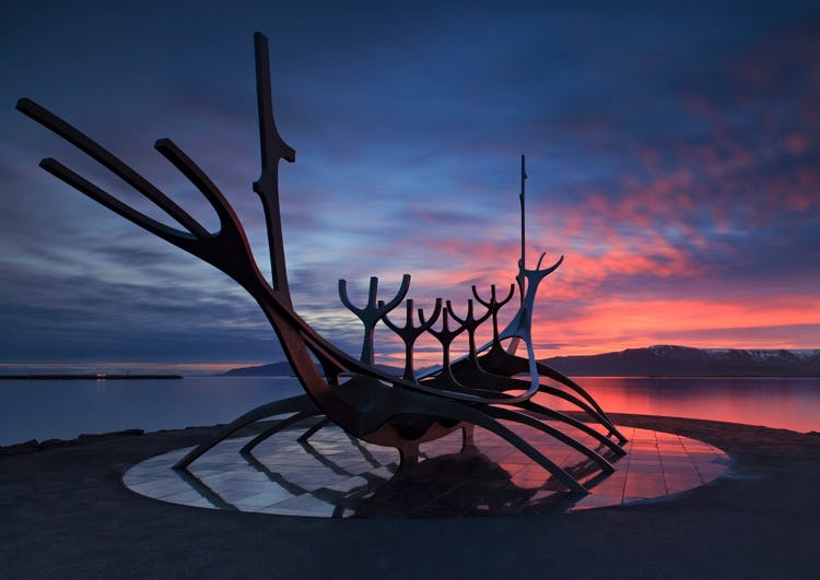The Sun Voyager in Reykjavík at sunset, creating a brilliant silhouette .