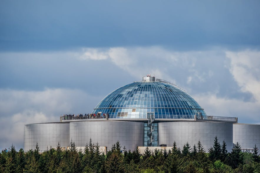 Perlan Museum and Observation Deck overlooks Öskjuhlíð woods.