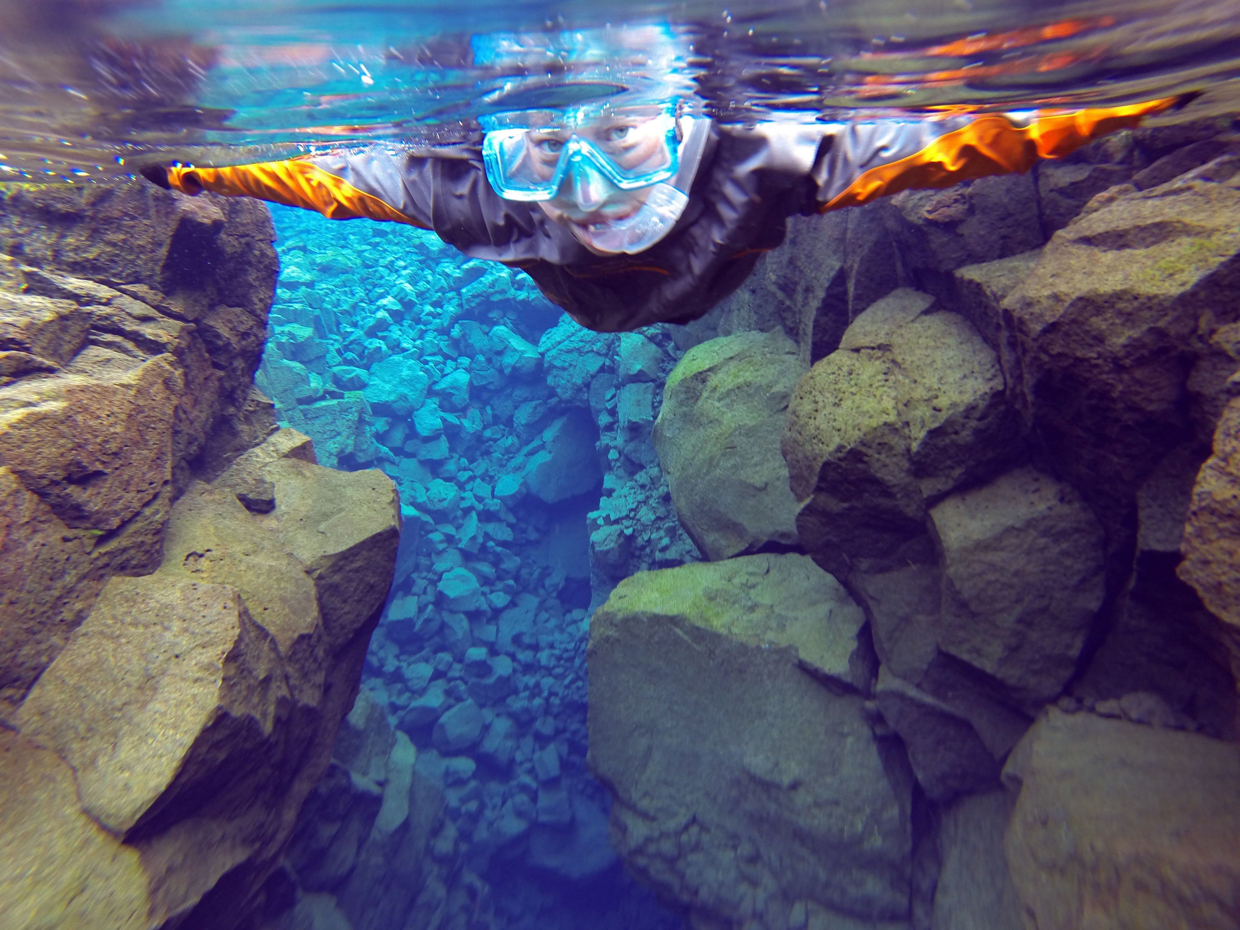 Throughout your time in Silfra, you will be wearing a drysuit - these protect you from both the cold and keep you buoyant in the water.