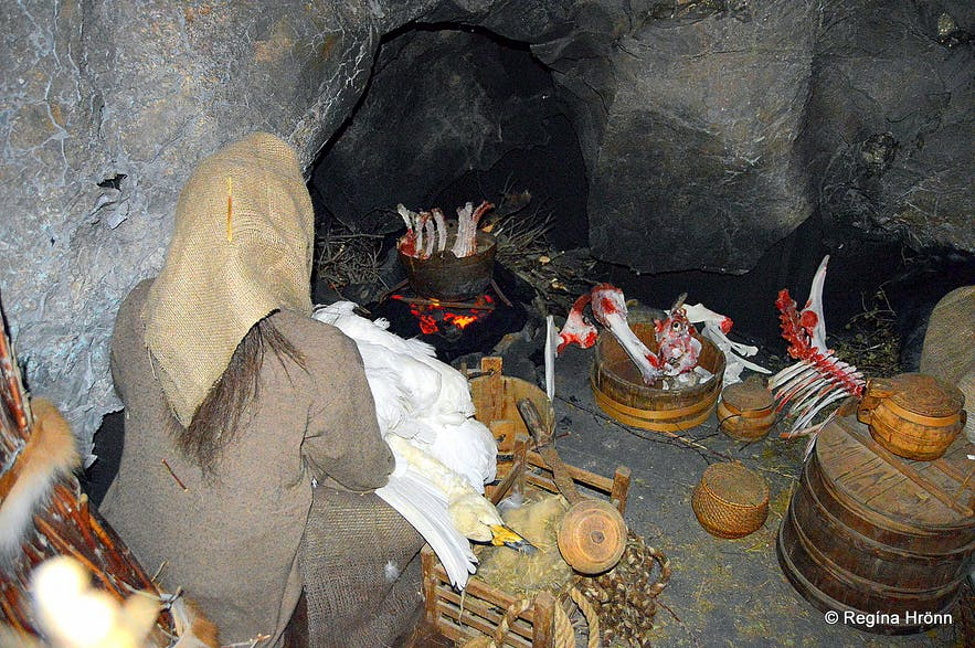 Halla preparing dinner in Eyvindarhellir cave at the exhibition in Blönduós village