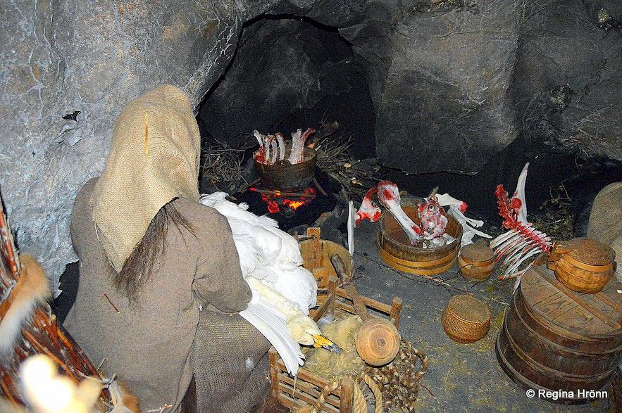 Halla preparing dinner in Eyvindarhellir cave at the exhibition in Blönduós village