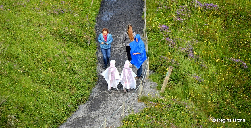 People on the path leading to Gullfoss waterfall