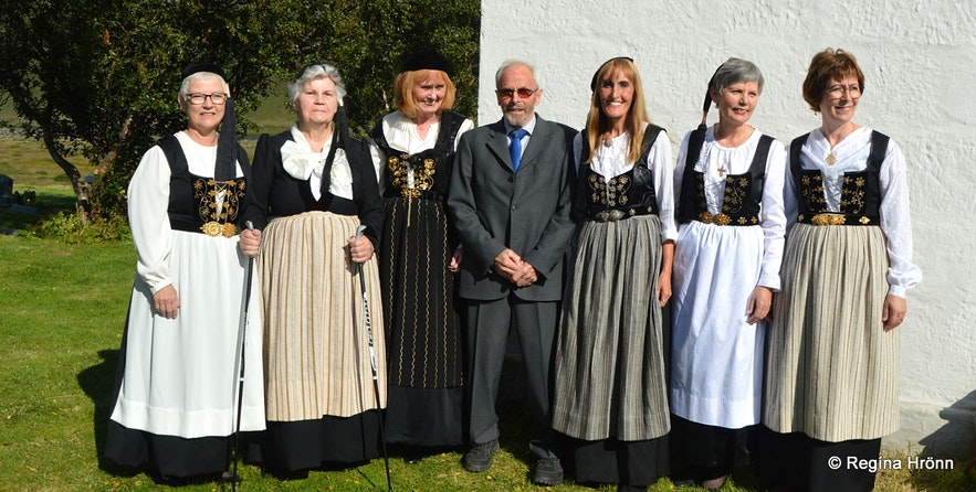 Regína dressed in a national costume by Þverárkirkja church North-Iceland