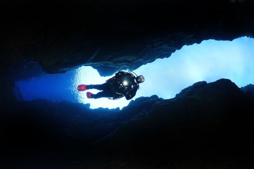 A scuba diver descends into Silfra Fissure.