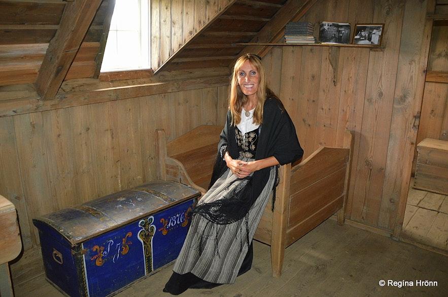 Regína inside Þverá Turf House in North-Iceland