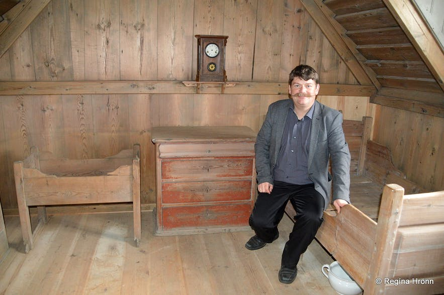 Regína's husband inside Þverá Turf House in North-Iceland