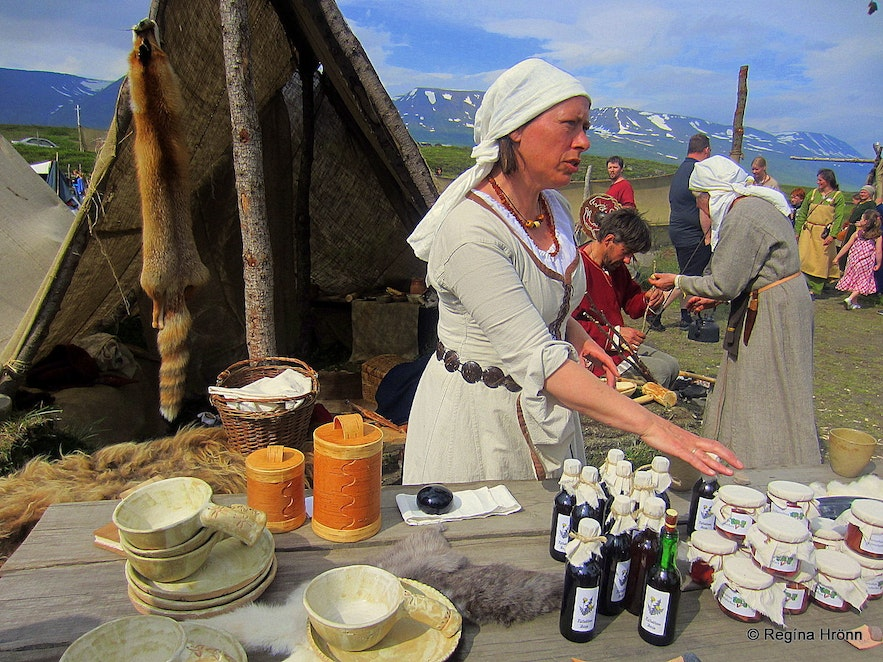 Woman selling goods at the medieval market at Gásir