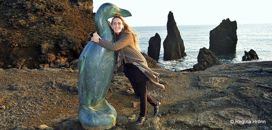 Regína by the great auk statue on Reykjanes