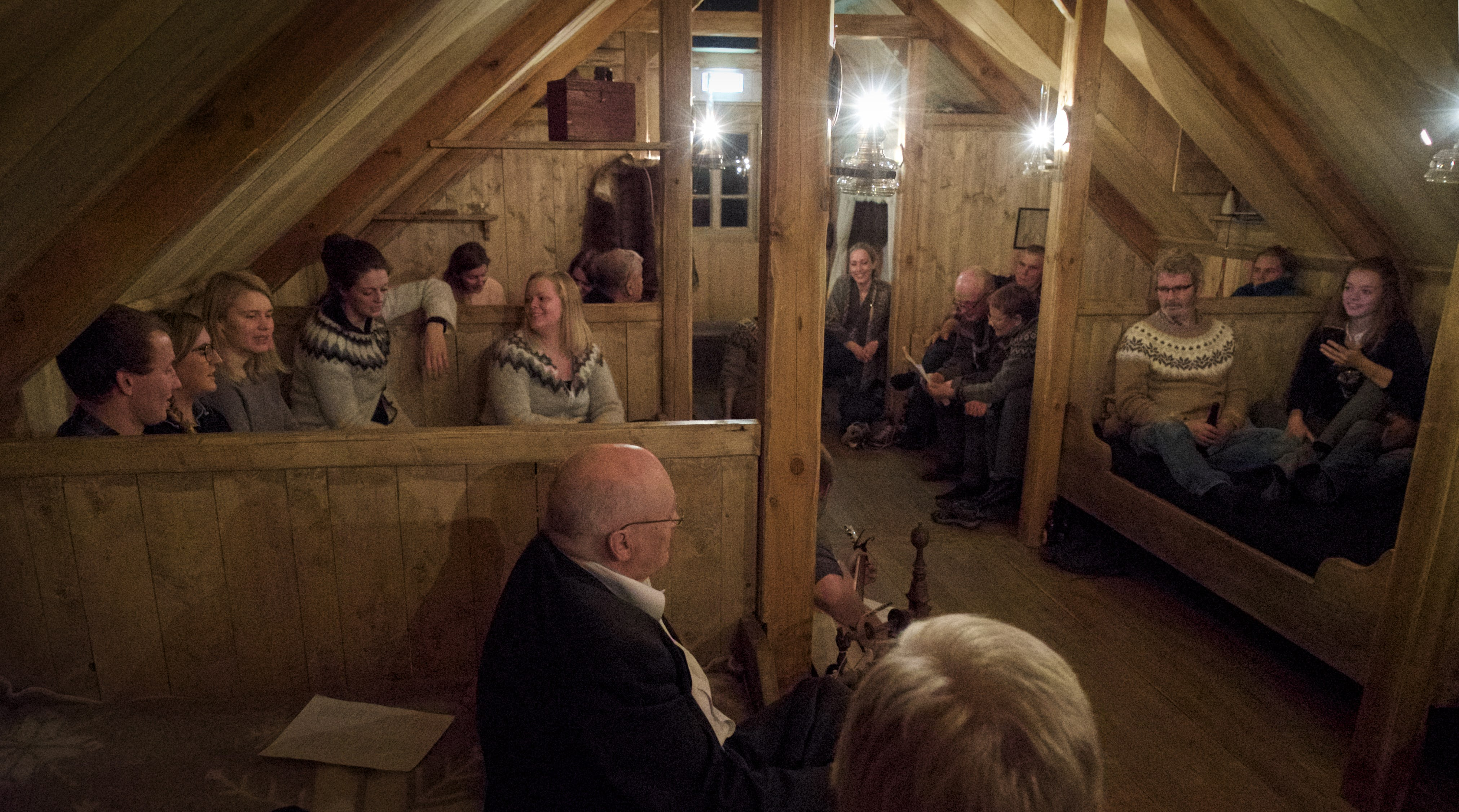A traditional evening of tales and chatting at an Icelandic traditional Baðstofa room in the Wilderness centre, East Iceland.